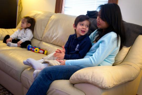 "During a winter of watching more TV than usual, Ngan Wedemeier of Wakefield joins her children, Nicholas, 4, and Madeline, 2, in watching their favorite show, ""Super Why!''"