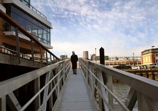 Developer William G. Curtis walked along the ramp that leads to boat moorings for the Liberty Wharf project, which includes five restaurants.