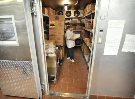 A cafeteria worker at Orchard Gardens Elementary School checked out the freezer food with packages that had 2010 use-by dates.