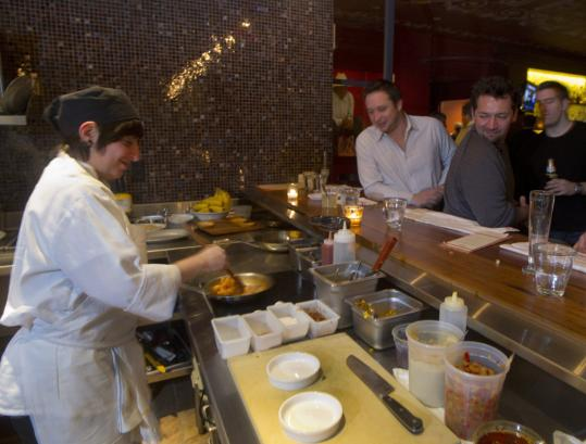 Laura Sotomayor (left) prepares an appetizer at Tico, opened by chef Michael Schlow.