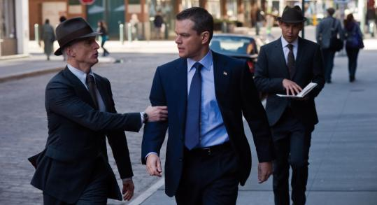 John Slattery (left) plays a member of the Adjustment Bureau that comes into the life of Matt Damon's political candidate, David Norris.