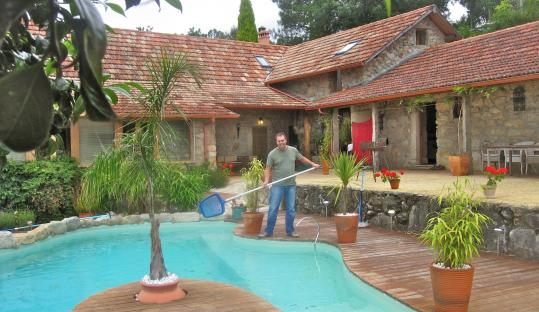 Andrew Peck, founder of Trustedhousesitters.com, tended a pool at a house in Galicia, Spain.