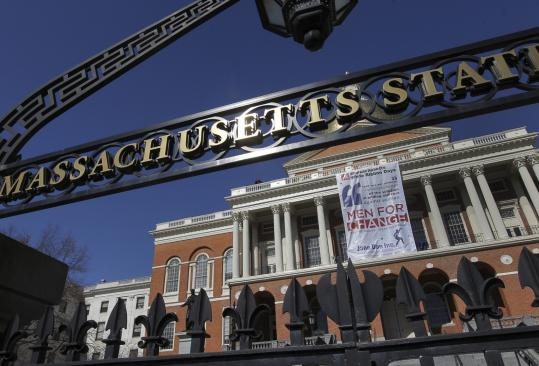 A banner celebrating Massachusetts White Ribbon Day was unfurled above the steps of the State House yesterday as part of the Jane Doe Inc.-sponsored campaign against domestic violence and sexual abuse. At left, Governor Deval Patrick and Lieutenant Governor Timothy Murray took part in the ceremony.