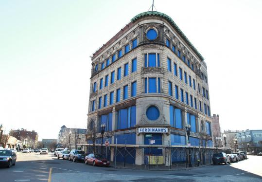 The Ferdinand Building in the heart of Dudley Square, a structure that's been vacant for three decades, would be the centerpiece of a redevelopment plan detailed by Mayor Menino yesterday.