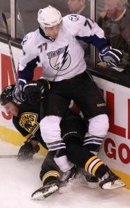 Bruins winger Brad Marchand got the worst of this collision with Lightning defenseman Victor Hedman.