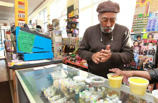 Sharif Abdal-Khallaq, co-owner of A Nubian Notion, a gift shop, said other squares in Boston have outpaced Dudley when it comes to development. Mayor Thomas M. Menino is working to revitalize the area.