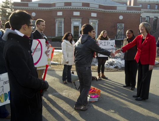Harvard president DrewFaust greeted demonstrators yesterday. About 15 students protested the exclusion of transsexuals and transgender individuals from serving in the military.