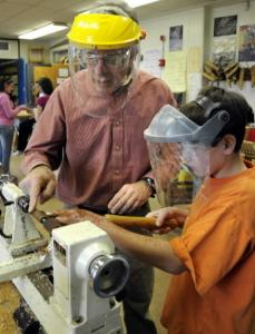 Wood shop teacher Ben Kellman instructs eighth-grade student Nick Barbas at a middle school in Bellerica.
