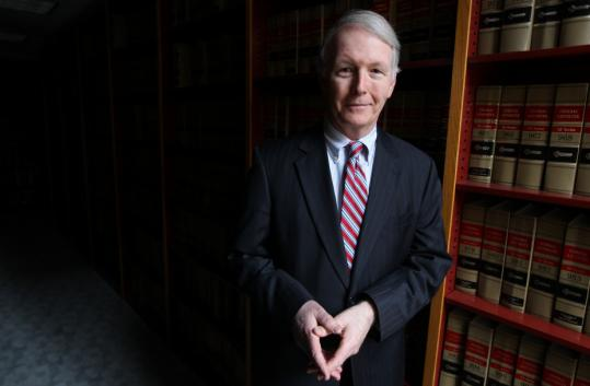 Belmont lawyer Ralph Sullivan will argue before the Supreme Judicial Court that he should not have to pay $75 to contest a $100 traffic ticket he received.