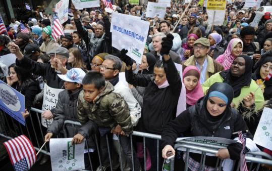 Protesters rallied in Times Square yesterday against a planned congressional hearing on alleged Muslim terrorism.