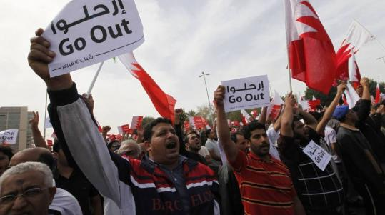 Antigovernment protesters held placards in front of the prime minister's palace in Bahrain.