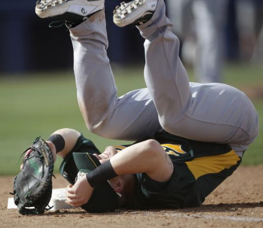 Athletics first baseman Daric Barton went down after he was hit while leaping for a throw, but the injury isn't a big concern.