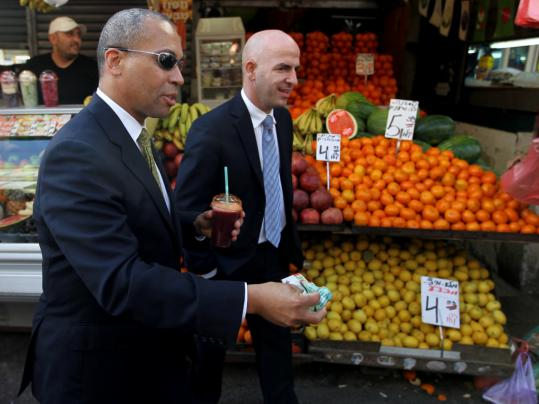 Shai Bazak, consul general of Israel to New England, and Governor Deval Patrick visited a market in Tel Aviv yesterday.