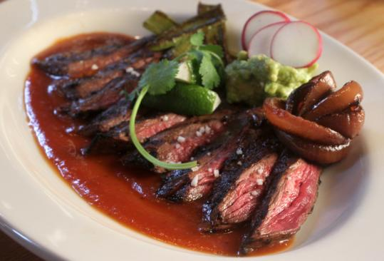 Carne asada, a skirt steak with guacamole and salsa at Lolita Cocina & Tequila Bar.