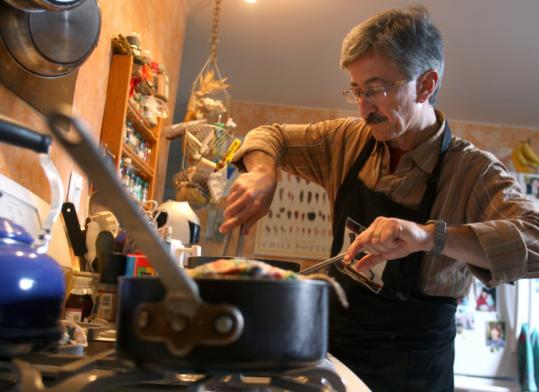 Brian Amador cooking in his Cambridge kitchen.