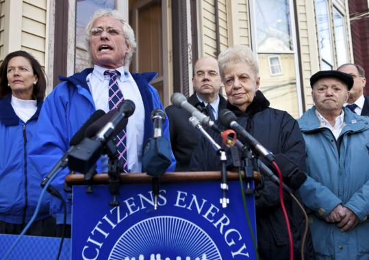Joseph P. Kennedy II addressed the media yesterday to oppose the proposed cuts to the Low-Income Home Energy Assistance Program. Among those with him were Katherine (center), 81, and Joe Oliveri (right), 84, who would be affected by the reduction.