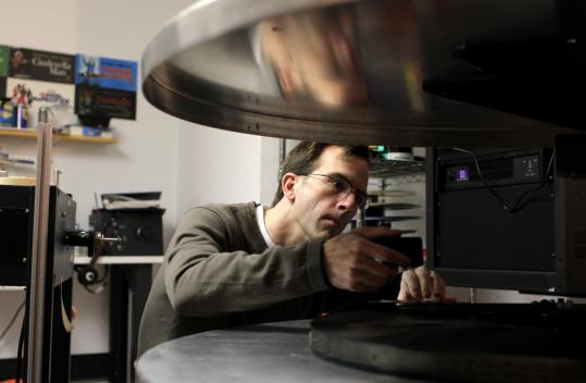 Bret Hardy in the projection room of Mill Wharf Cinemas in Scituate. He and his wife, Michelle, operate Mill Wharf and Cameo Theaters.