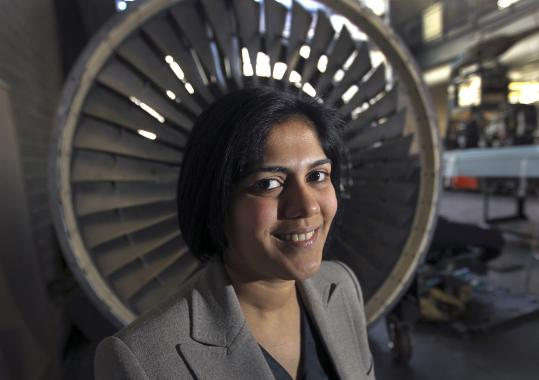 MIT assistant professor Hamsa Balakrishnan, shown with a jet engine behind her, oversaw research looking at the flow of planes at Logan.