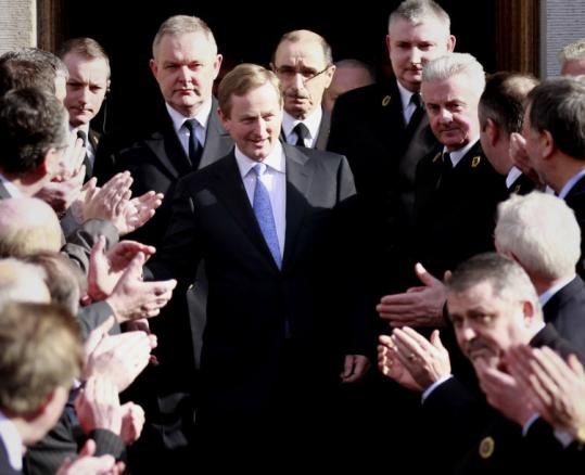 Ireland's new prime minister, Enda Kenny, was greeted by Fine Gael party members in Dublin yesterday.