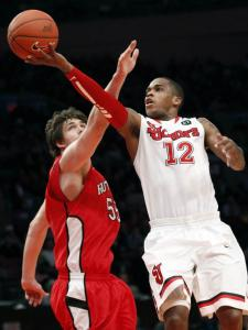 St. John's Dwight Hardy drives past Rutgers' Gilvydas Biruti to score 2 of his 17 points in the Red Storm's second-round win.