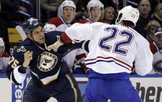 Ryan Reaves of the Blues tangles with Canadiens defenseman Paul Mara during the second period of St. Louis's win.