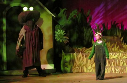 Audree Hedequist (Young Frog) commands the stage in her scene with Large and Terrible Frog, played by Conrad Kendel-Clark.