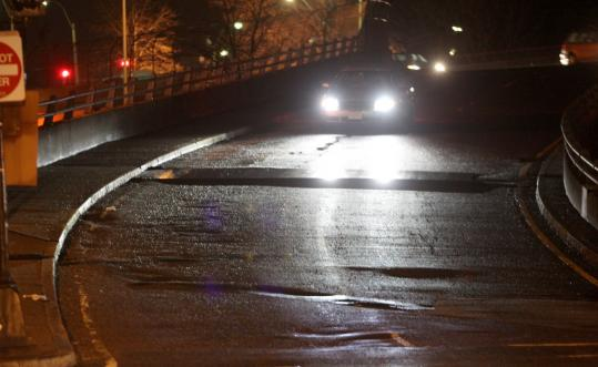 Steel plates were laid across the 12-foot pothole that ruptured across a Bowker Overpass ramp.