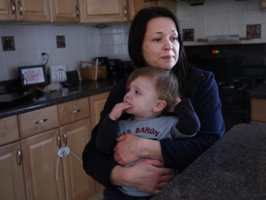 Theresa Strang with her son, Eamonn. Strang moved from West Roxbury to Natick after her 4-year-old did not get into pre-kindergarten last year.
