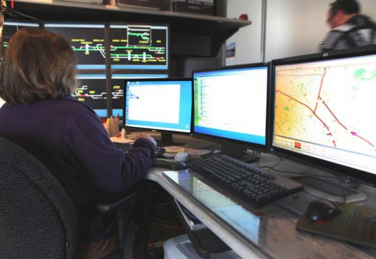 A dispatcher at the commuter rail center in Somerville. Workers there monitor the North Station lines.