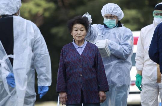 Residents evacuated from areas around the Fukushima nuclear plant were checked for radiation yesterday in Koriyama.