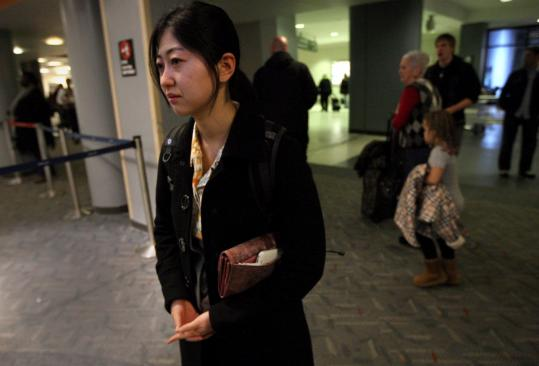Shoko Takemoto returned to Logan airport from an interview trip to Japan. She was in Kamakura when the earthquake struck, and spent Friday night in a shelter with her sister feeling the aftershocks.