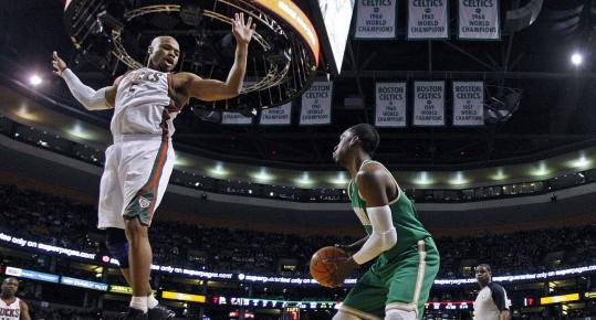 Jeff Green (right) of the Celtics waits for Milwaukee forward Corey Maggette to land before making his move.
