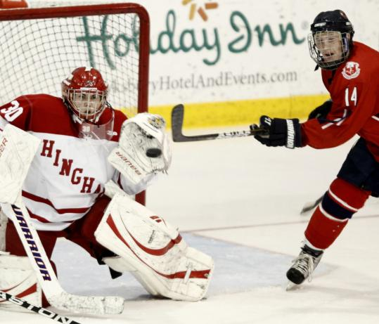 Hingham goalie Derek McInnis keeps his eye on the puck, despite the distracting presence of Central Catholic's Nick Leonard. Both teams have been eliminated from the Super 8.