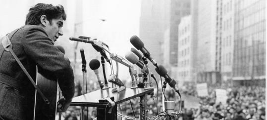 Phil Ochs performing during a Vietnam moratorium demonstration outside the UN Building in New York City in 1967.