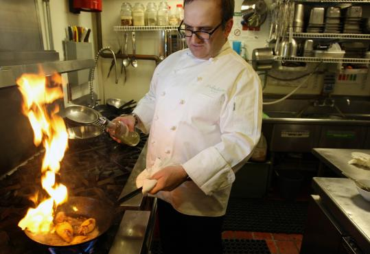 Chef Charles Draghi of Erbaluce puts the squid in a red-hot skillet, searing the edges. He serves it with a vinaigrette or a relish.