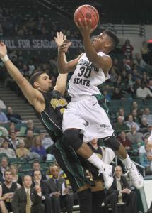 Despite close-up coverage from Vermont's Luke Apfeld, Cleveland State's Norris Cole goes in for a layup, 2 of his 27 points in the Vikings' win.