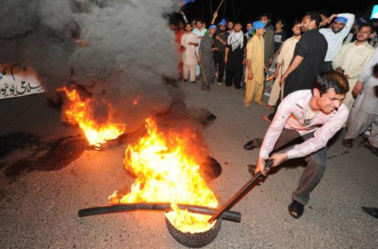Protesters burned tires during a protest yesterday in Islamabad against the release of CIA security contractor Raymond Davis.