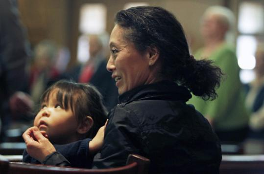Yumiko Ishizawa, with her daughter, 2-year-old Athena, attended the Interfaith Prayer Service for People of Japan yesterday at The Paulist Center Boston. Ishizawa also spoke at the service.