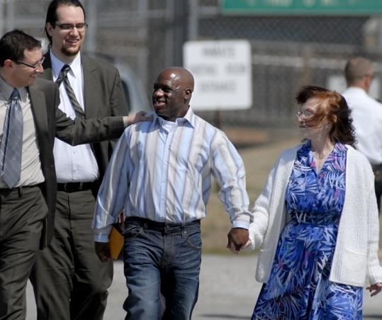 Eric Caine (center) talked with his attorney Russell Ainsworth of the Exoneration Project at the University of Chicago Law School as Caine walked with his girlfriend, Sara Bush.