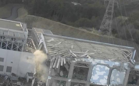 An aerial photo taken from a helicopter shows damage to the No. 4 reactor at the Fukushima Daiichi nuclear power complex.