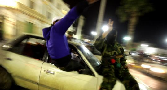Libyan rebels paraded in Benghazi yesterday after Moammar Khadafy announced an imminent attack on the city.