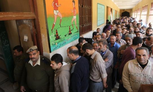 Egyptians lined up at a polling station in Mansoura yesterday as voters got their first taste of democracy in a referendum on a package of constitutional changes.