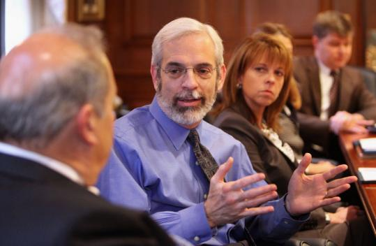 Blue Cross Blue Shield chief Andrew Dreyfus spoke with health care executives at Lowell General Hospital on Friday.