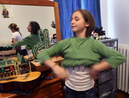 Nicole Rezza, the current Miss Ice-O-Rama, tries on an outfit she may wear in the St. Patrick's Day parade.
