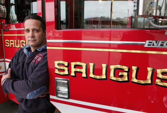 "Saugus firefighters' union chief Bill Cross believes accepting a lesser insurance plan was necessary. ""We had to look at the big picture,'' he says."