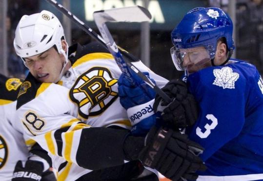 Toronto's Dion Phaneuf (right) outmuscled the Bruins' Nathan Horton along the boards in the second period.