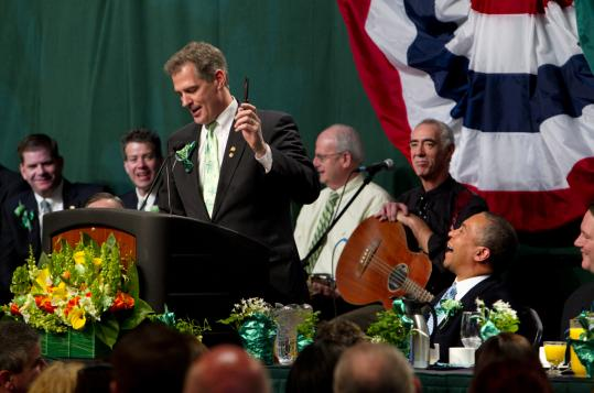 Massachusetts Senator Scott Brown gave a joke gift to Governor Deval Patrick yesterday at the annual St. Patrick's Day Breakfast at the Boston Convention & Exhibition Center.