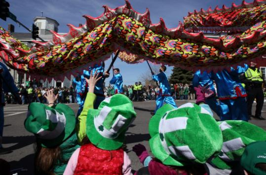Children watched a Falun Dafa group perform at the annual Saint Patrick's Day Parade in South Boston.