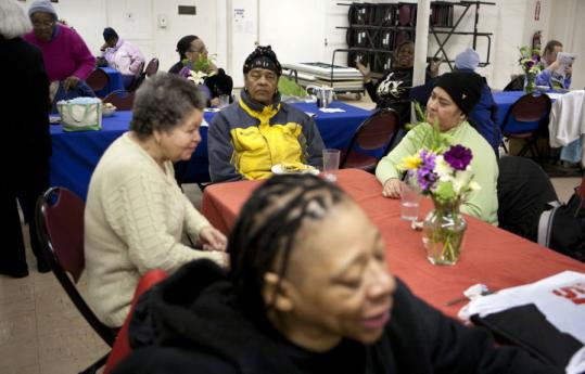 A rectangular-shaped dining and gathering space dominates most of the basement at the Women's Lunch Place Shelter.