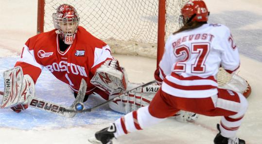 Boston University freshman goalie Kerrin Sperry flashes out her left pad to deny Carolyne Prevost for one of her 32 saves in a losing effort in the championship game.